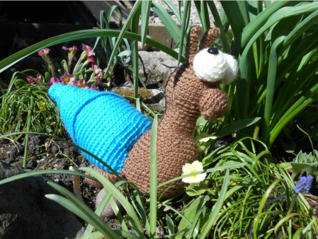 My crochet snails are starting to improve... (well as lovely as the patio is, it would have been a very colourful photo)