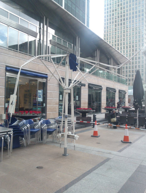 27th January 2014:  The strong winds got to the restaurant umbrellas at Canary Wharf.  I tried to start a rumour that actually a giant elephant had sat on this one, but people just looked at me funny...