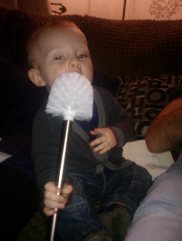 23rd February 2014: Little Pea eating a (brand new) toilet brush.  Obviously.