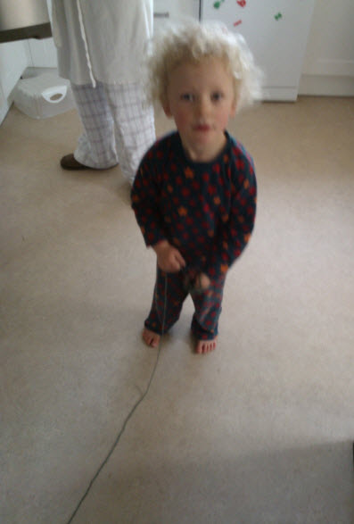 1st March 2014:  A bit blurry, but this is Gorgeous Godson, the morning of his birthday, rather happy with his wool!