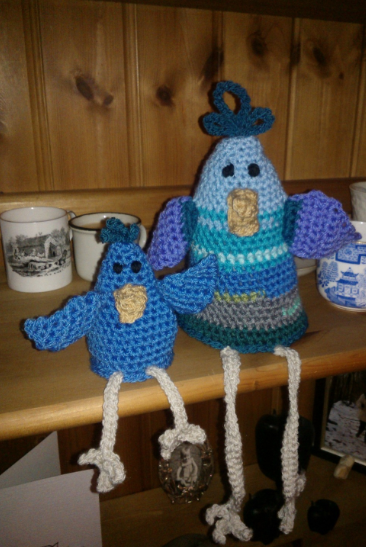 egg cosy on the left, giant chicken on the right