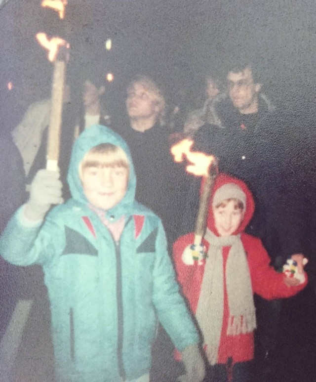 November 1983 Carrying burning torches at the local fireworks display (only in the 80's would children have been encouraged to walk in a crown with sticks on fire!)