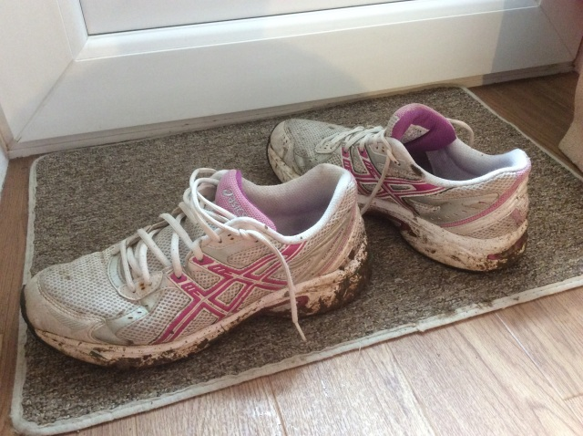 Used, muddy and happy trainers